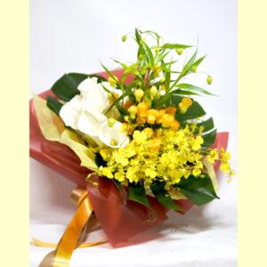 サンダーソニアとオンシジウム、カラーの花束